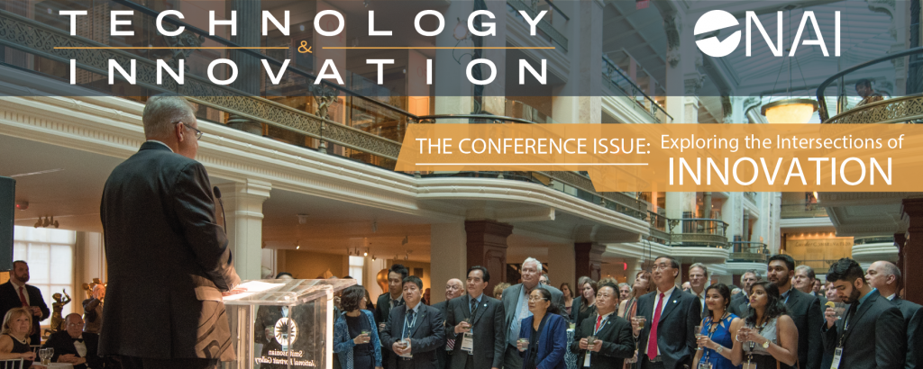 """T&I graphic with a picture of a white man at a podium, speaking to a crowd. Text overlay reads """"The Conference Issue: Exploring the Intersections of Innovation"""""""